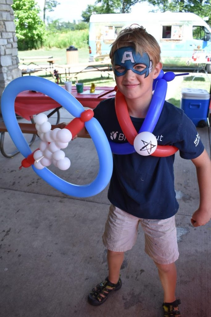 Young Future Client with Captain American face paint and balloons