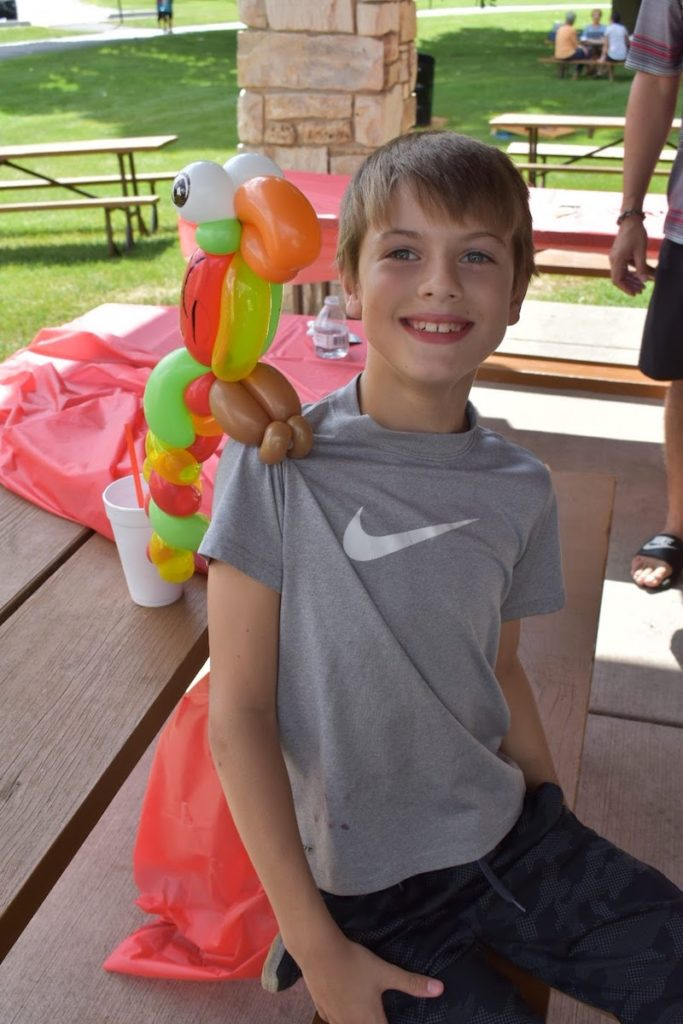 Young Future Client with Balloon Parrot