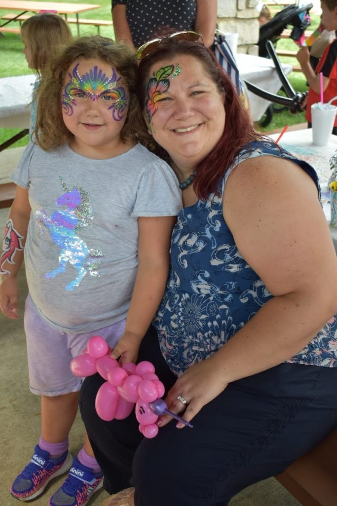 Mom and Daughter with Face painting at the Ice Cream Social