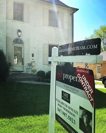Under Contract Sign in front of home